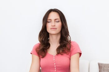 A woman relaxing after hypnotherapy at The Psychology Group Fort Lauderdale | Psychologists and Therapists in Broward County South Florida