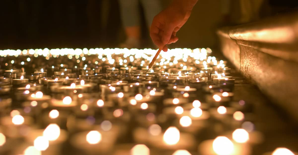 Coping With Grief During The Holidays | Hand Lighting a Candle Coping With Depression in Fort Lauderdale